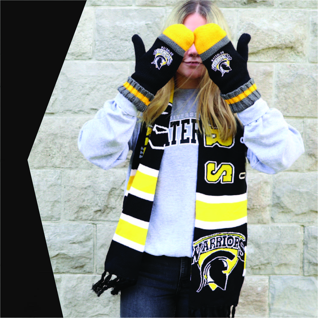 Person hiding from winter with Warriors mittens and scarf