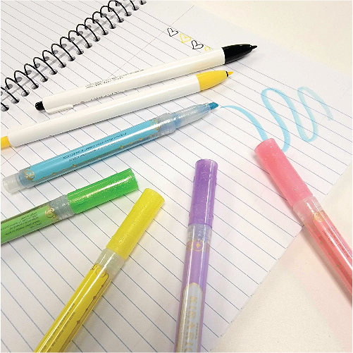 Highlighters and highlighter pens on a notebook